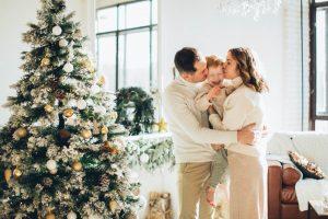 Family next to Christmas tree